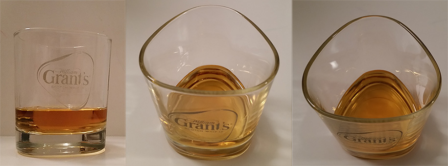 Whiskey tumbler glass with William Grant's logo