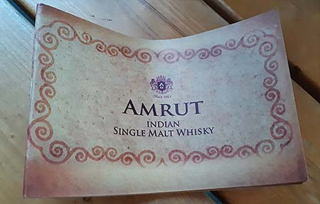 Brochure from Amrut cask strength whisky package